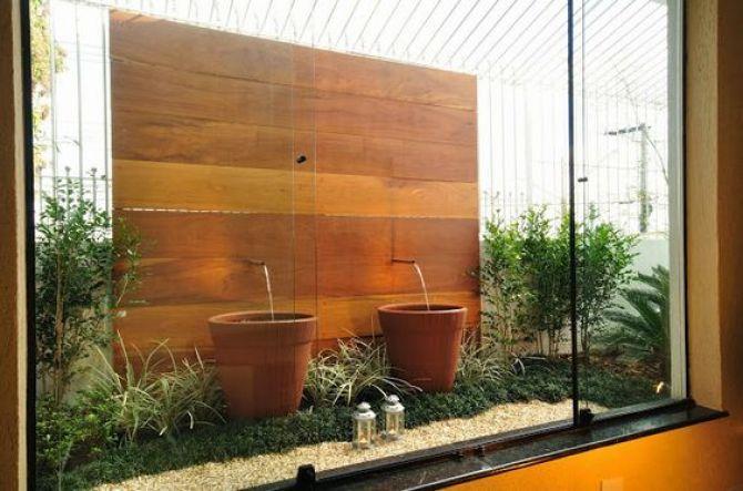 Deixe o jardim de inverno mais bonito com fontes ou cascatas