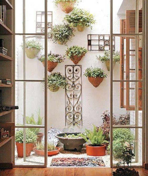 Vasos para decorar o jardim de inverno