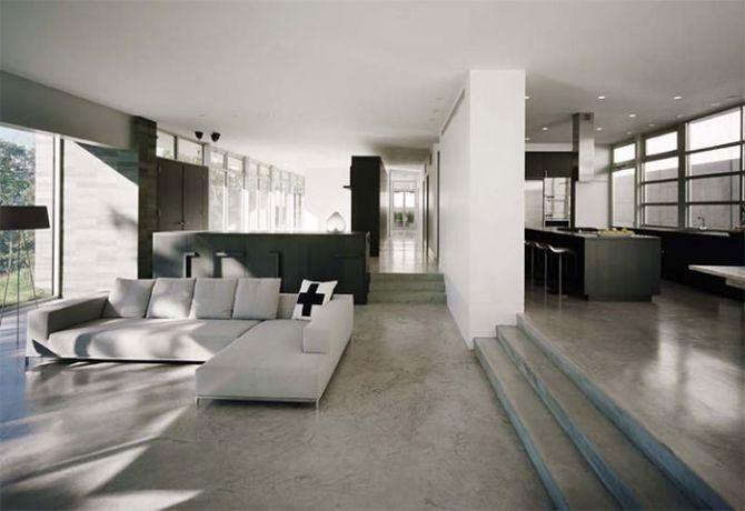O piso de cimento queimado é uma opção para dar amplitude a sala